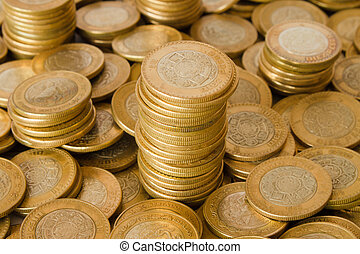 a lot of golden coins, mexican ten pesos coins