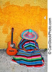Mexican typical lazy man sombrero hat guitar serape