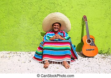 Mexican typical lazy topic man guitar poncho sit
