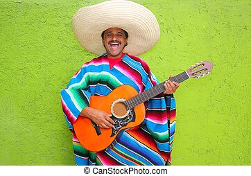 Mexican typical man playing guitar poncho