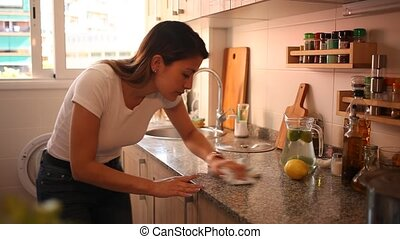 Mexican woman housewife is cleaning furniture at home ...
