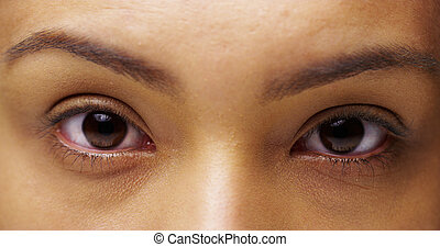 Mexican woman looking at camera with sultry eyes
