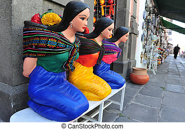 Mexican woman statues in the street of Puebla City, Mexico.