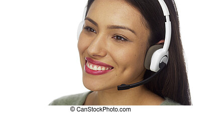 Mexican woman telemarketer talking and smiling