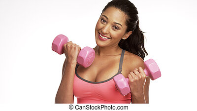 Mexican woman working out with weights