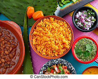 Mexican yellow rice with chilis and frijoles
