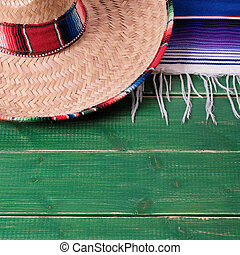 Mexico cinco de mayo fiesta wood background mexican sombrero