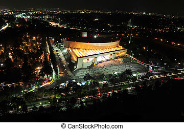 View of the business district and National Auditorium of Mexico City at night.