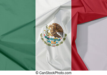 Mexico fabric flag crepe and crease with white space, a vertical tricolor of green white and red with the nation Coat of Arms.