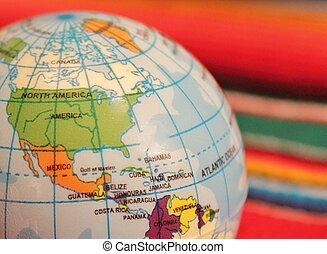mexico fiesta background - Globe showing Mexico and poncho...