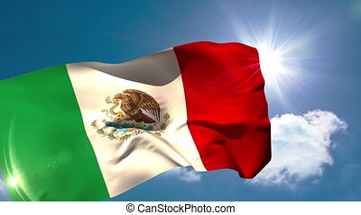 Mexico national flag blowing in the breeze on blue sky...