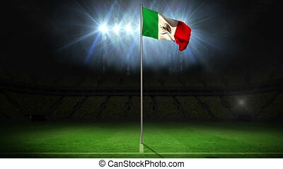 Mexico national flag waving on flagpole on football pitch...