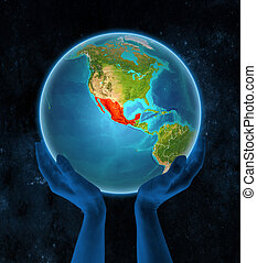Mexico on Earth in hands in space