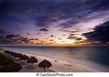 Mexico - Sunrise along the white sand beaches of Cancun on...