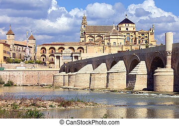 Mosque Cathedral (Spanish: La Mezquita) and Roman Bridge on Guadalquivir river in Cordoba, Spain, Andalusia region.