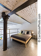 Mezzanine bedroom in industrial style idea - Image of a...