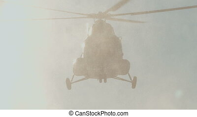 Mi-8 helicopter in the air, spinning blades. snowy weather.
