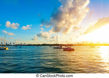Miami Beach bayfront under a shining sun at sunset