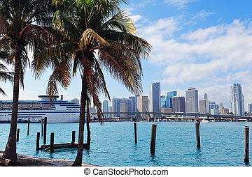 Miami city tropical view over sea from dock in the day with...