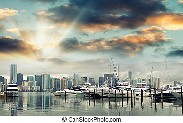 Miami Downtown at sunset with anchored boats