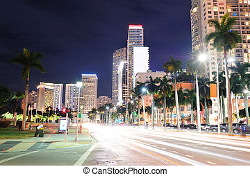 Miami downtown street view at night with hotels.