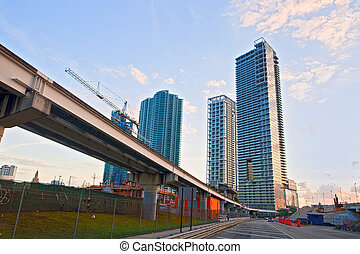 Miami Florida, Brickell and downtown financial buildings and train bridge on a beautiful summer day with blue sky