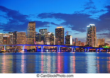 Miami night scene - Miami city skyline panorama at dusk with...