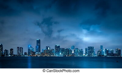 Miami skyline at night with clouds passing by