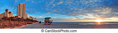 Miami South Beach sunrise with hotels and coastline with...