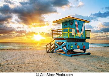 Miami South Beach sunrise with lifeguard tower and coastline...