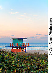 Miami South Beach sunset with lifeguard tower and coastline ...