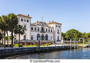 Miami Vizcaya museum at waterfront under blue sky