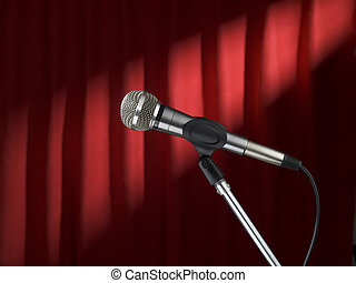 Mic on stage - A microphone on stage over a red background.