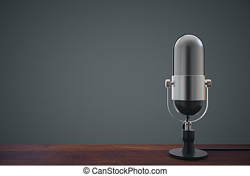Mic on wooden table - Wooden surface with microphone on dark...