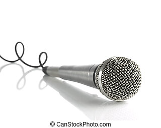 A dynamic mic with a curled cable over white.