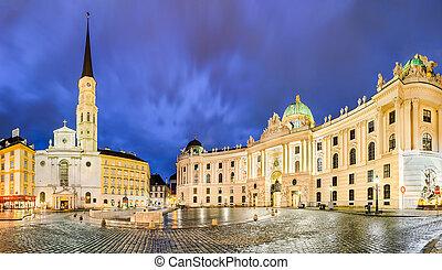 Michaelerplatz in Vienna, Austria at night with Hofburg and...