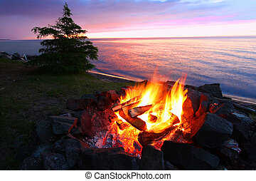 Michigan Beach Bonfire - A campfire on the beach is a...