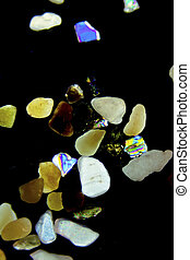 Micro photography of sand grains in polarized light