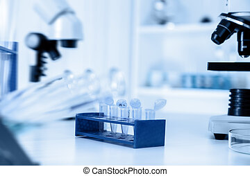 Micro tubes with biological samples in laboratory for DNA ...
