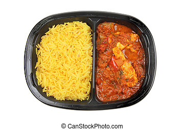 Convenience food, chicken Jalfrezi and Pilau rice in a plastic carton isolated against white