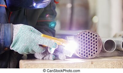 Micro welding. Operator preparing and use electro spark...