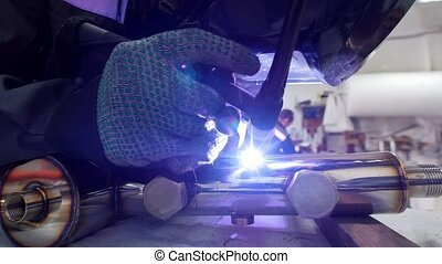 Micro welding. Operator use electro spark engraving...