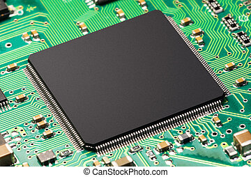 Creative abstract electronic technology and computer PC hardware business concept: macro view of CPU or chip on green printed circuit board PCB