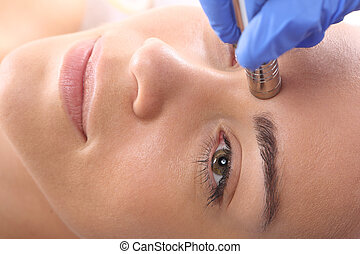 Microdermabrasion - Relaxed woman during a microdermabrasion...