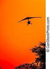 Microlite Aircraft at Sunset