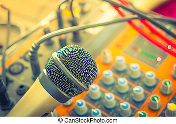 Microphone and Music mixer desk with various knobs (...