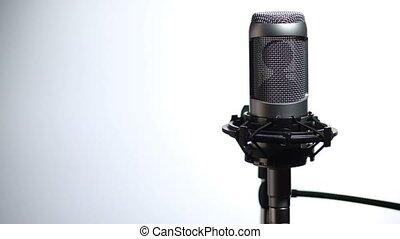 Microphone and pop filter in sound studio - Closeup female...