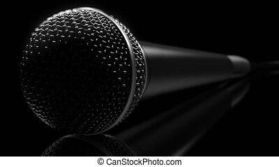 Microphone close-up against dark background - Microphone...