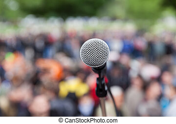 Microphone in focus against blurred audience. Protest. -...