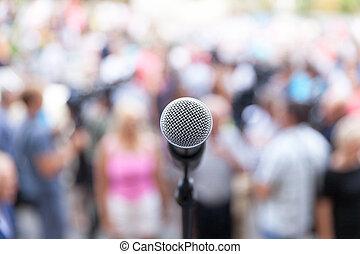 Microphone in focus against blurred audience - Mic in focus...